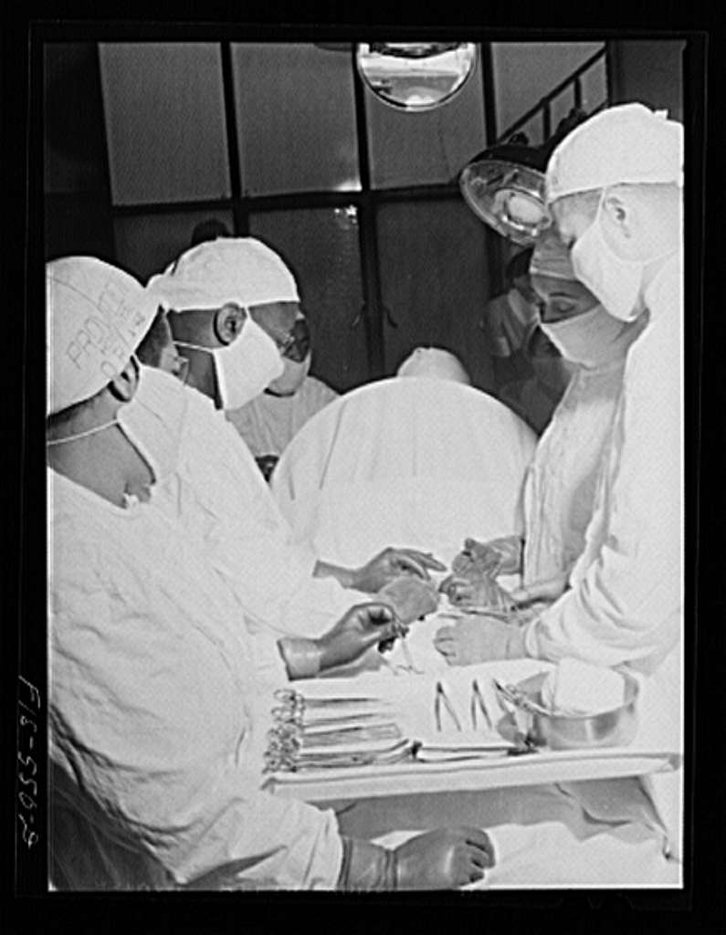 Chicago, Illinois. Provident Hospital. Doctors and interns at a (mock) operation