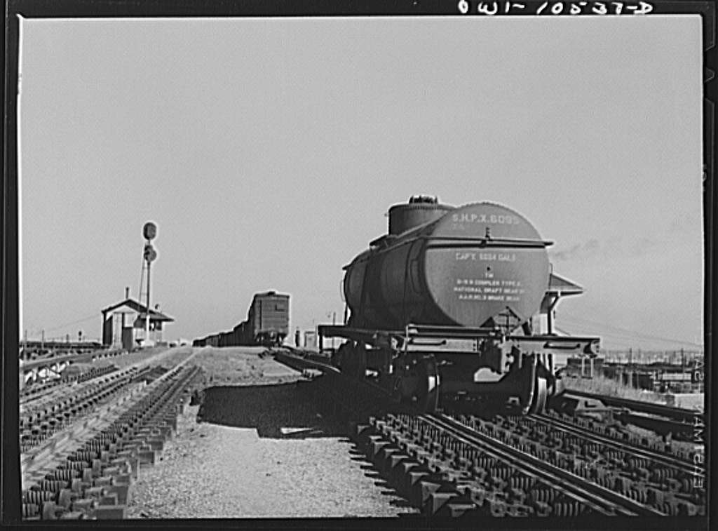 Chicago, Illinois. Tank car going over the retarder at the south hump at an Illinois Central Railroad yard