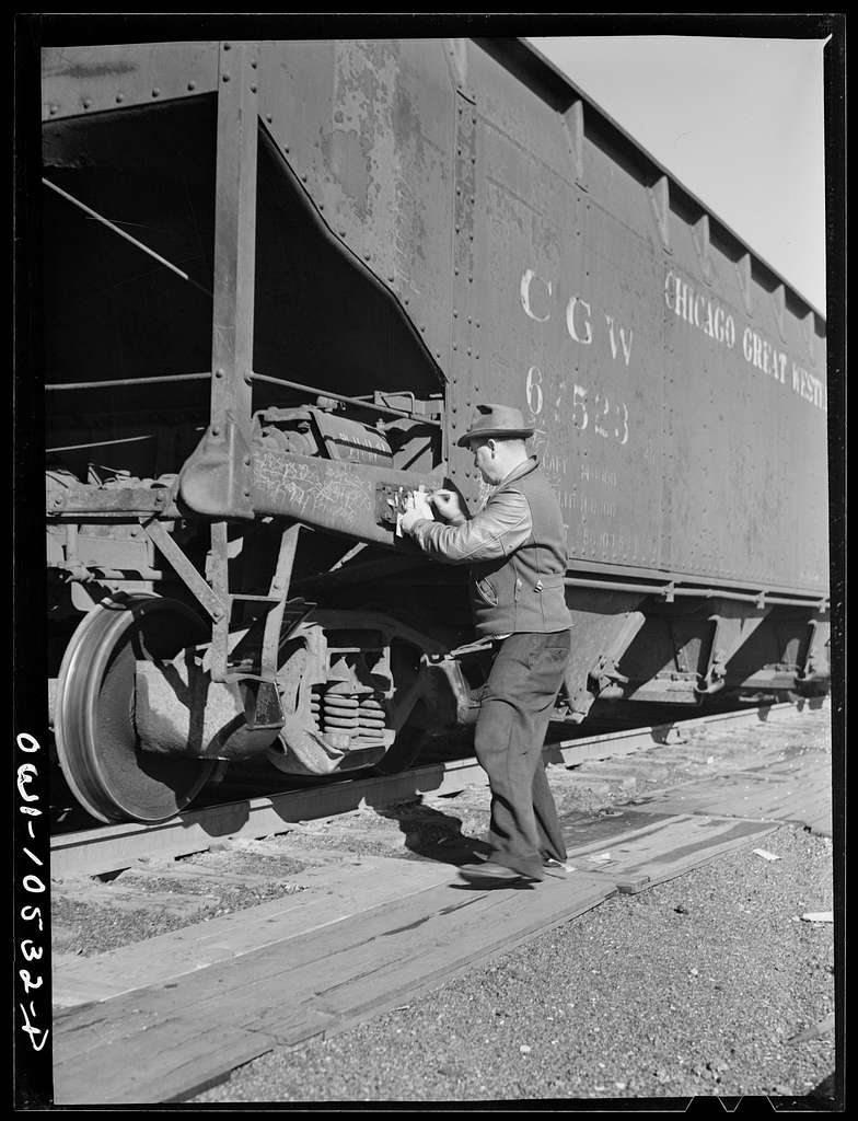 Chicago, Illinois. Train clerk marking cars as they go over the hump at an Illinois Central Railroad yard
