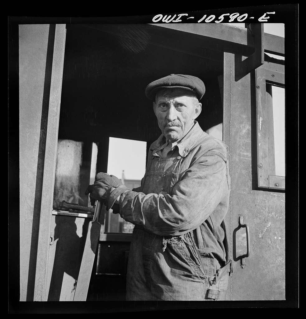 Chicago, Illinois. Turntable operator at the roundhouse at an Illinois Central Railroad yard