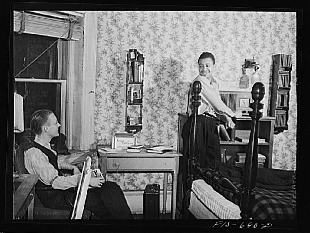 Chicago, Illinois. Two of a group of young men who live cooperatively in a large house