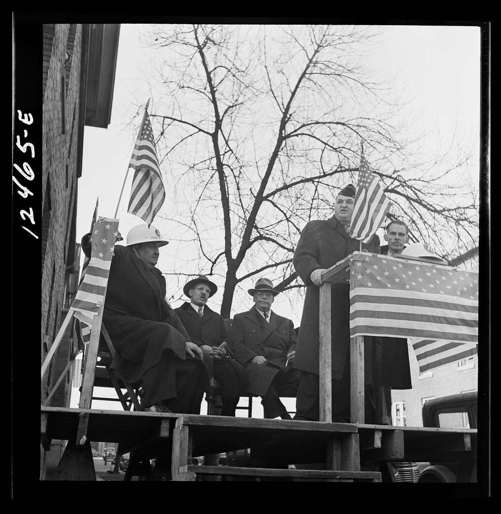 Chicago (north), Illinois. Speakers at a neighborhood flag dedication ceremony