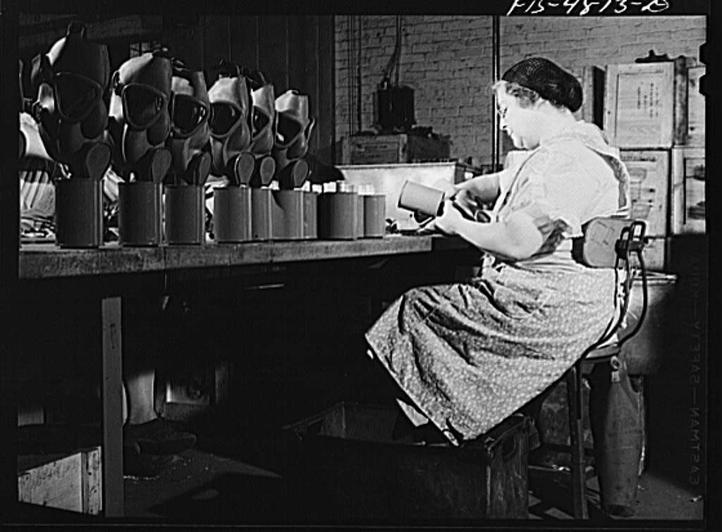 Edgewood Arsenal, Maryland. Gas demonstration. Working on reconditioned gas masks for civilian defense use at the gas mask factory