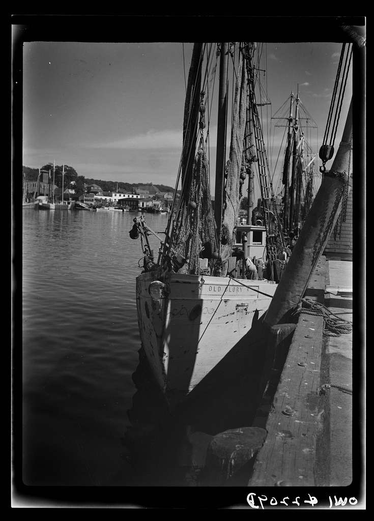 Gloucester, Massachusetts. Heavy nets slide down Old Glory's side at fishing grounds off the New England coast where rosefish are being sought. This species of fish can be caught only in the daytime
