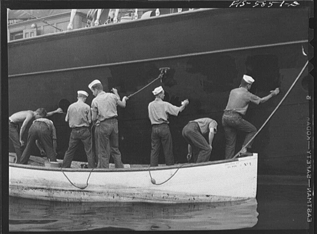 Hoffman Island, merchant marine training center off Staten Island. Trainees painting the schooner Vema