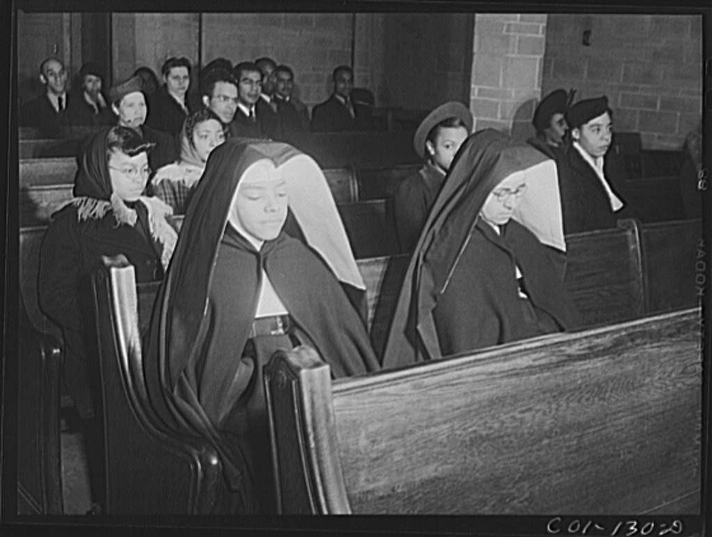 Negro nuns at a Negro Catholic church service on the South Side of Chicago, Illinois