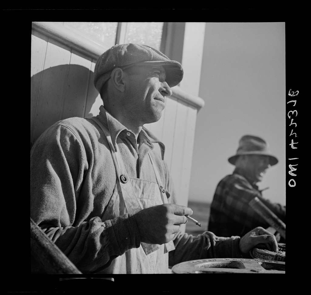 On board a fishing vessel, out from Gloucester, Massachusetts. A winch control man