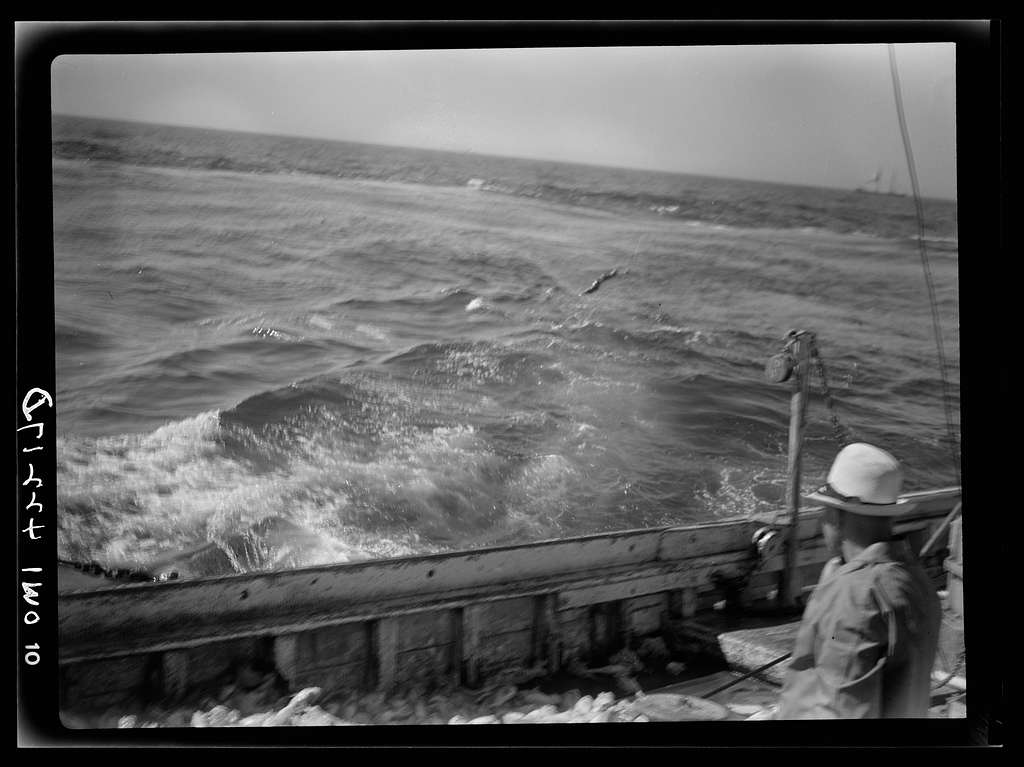 On board a fishing vessel out from Gloucester, Massachusetts. View of choppy waters