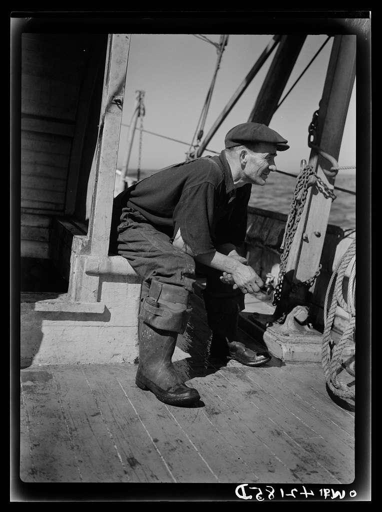 Portrait of a fisherman on board a fishing vessel out from Gloucester, Massachusetts