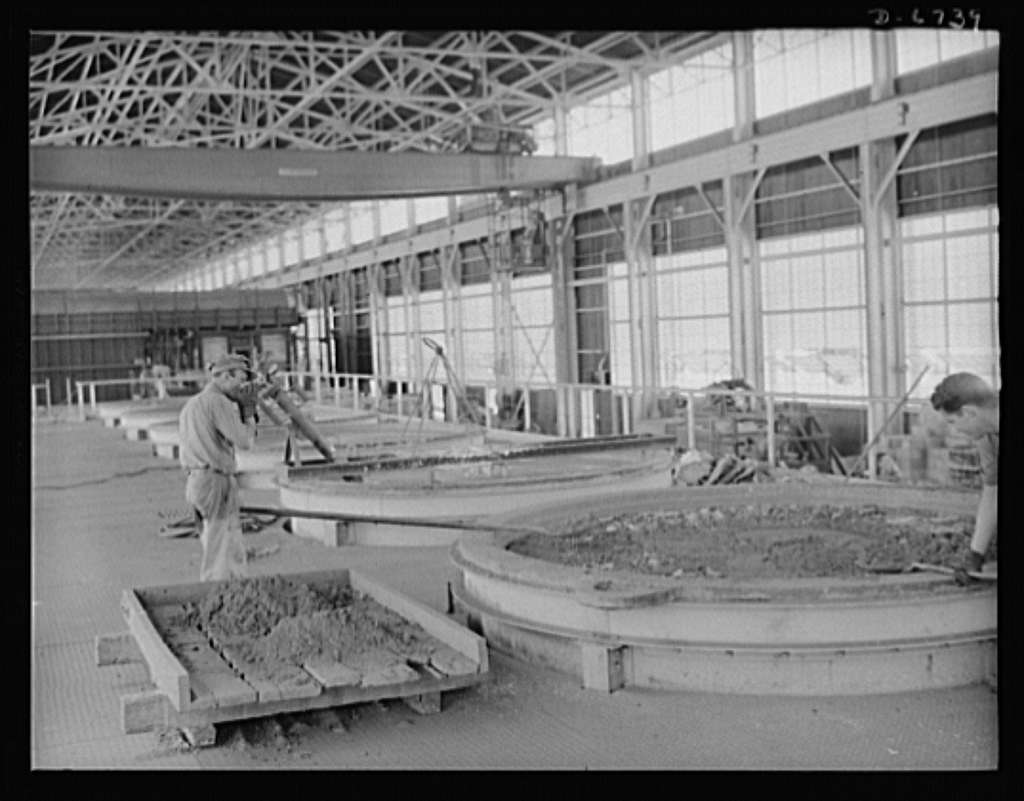 """Production. Tin smelting. """"Pot boilers"""" of a Southern tin smelter in which the pure metal is kept at a temperature of about 750 degrees Fahrenheit until it is poured into molds. The plant, which processes South American ore is the finest and the most modern in the world"""