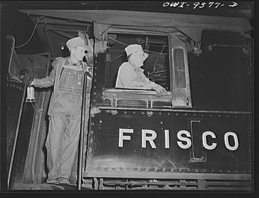 Tulsa, Oklahoma. Engineer and fireman of a train going through Tulsa at night