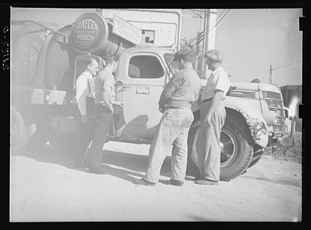 Washington, D.C. A Jaeger truck-transit mixer showing four men looking at the United States Truck Conservation Corps pledge on the door of the truck
