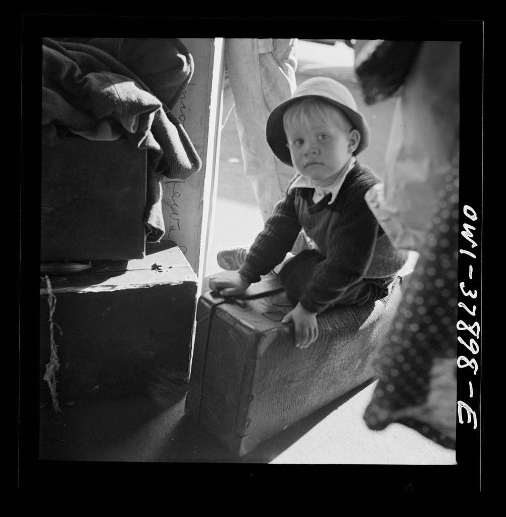 A Greyhound bus trip from Louisville, Kentucky, to Memphis, Tennessee, and the terminals. Small boy waiting for the bus at Chattanooga