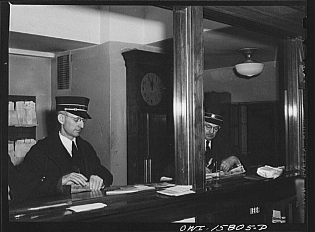 Chicago, Illinois. Conductors checking in at the dispatcher's office at the Union Station