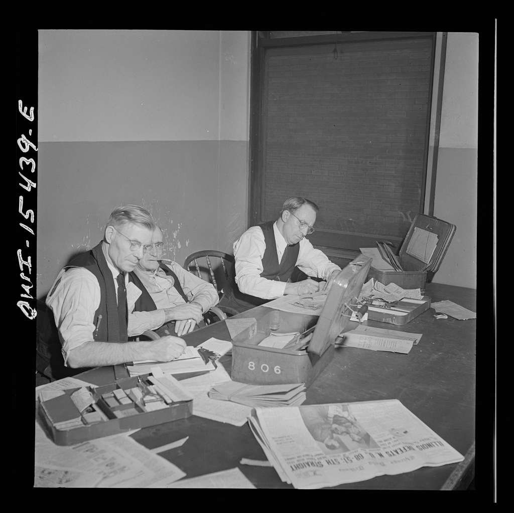 Chicago, Illinois. Conductors checking on their recepits and tickets in their locker and rest room in Union Station