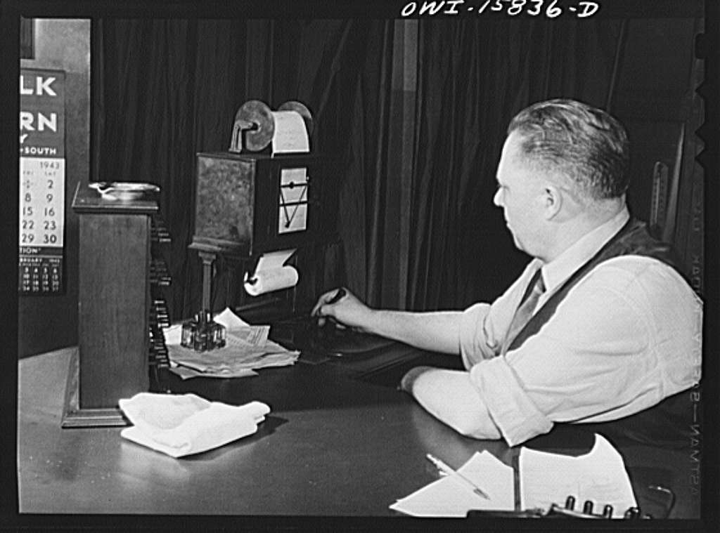 Chicago, Illinois. Mr. Trout, in charge of the south tower, sends a message on the telautograph. It will go to many points in the Union Station including the station masters office, the information desk, the passenger agents' office, telephone information room, etc