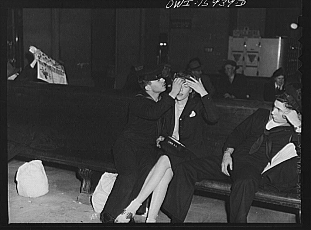 Chicago, Illinois. Sailor helping his girlfriend fix her hair at Union Station