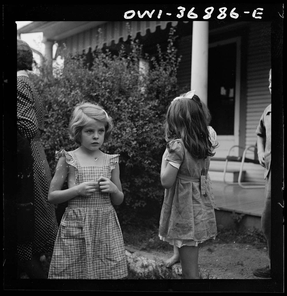 Children watching a Greyhound bus that broke down in a small town in Pennsylvania on the way to Pittsburgh from Washington, D.C