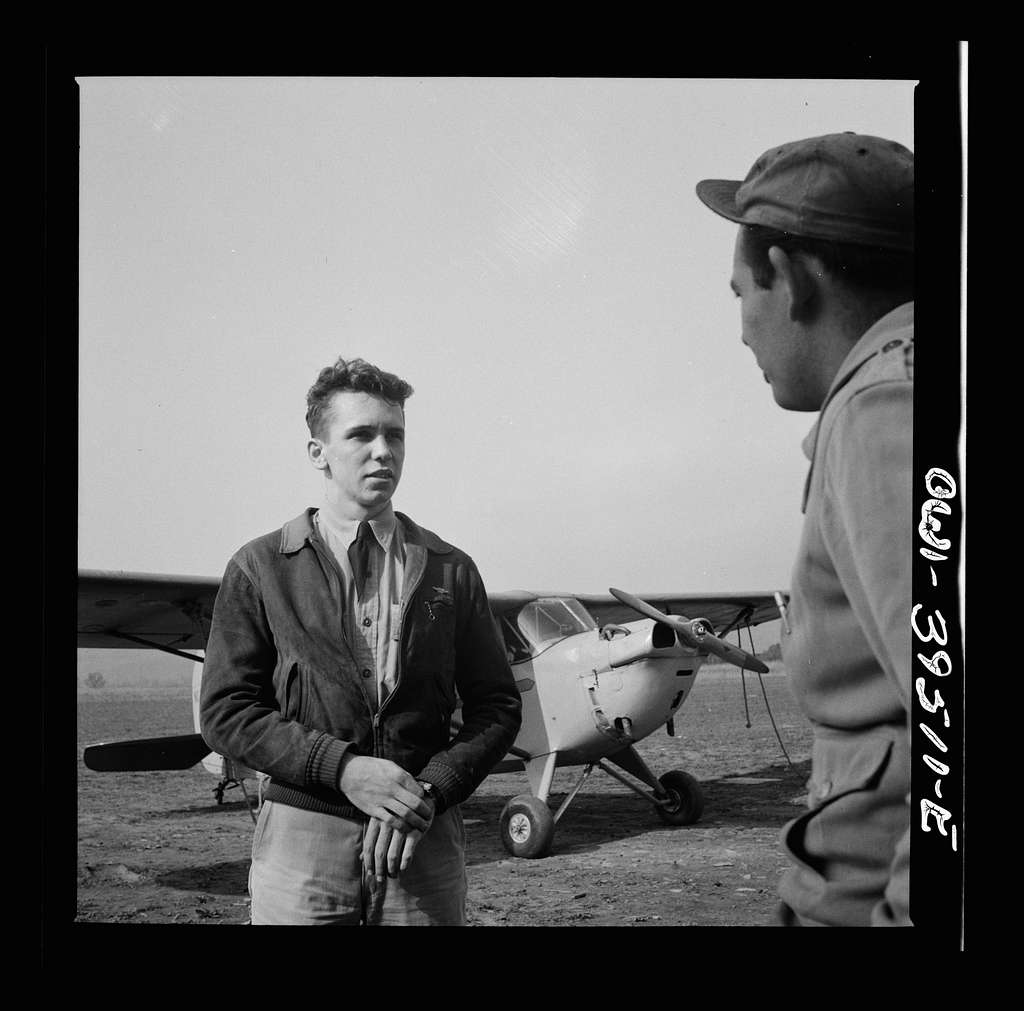 Frederick, Maryland. After a solo flight, Walter Spangenberg, a student at Woodrow Wilson High School, listens to a criticism from his instructor at Stevens Airport