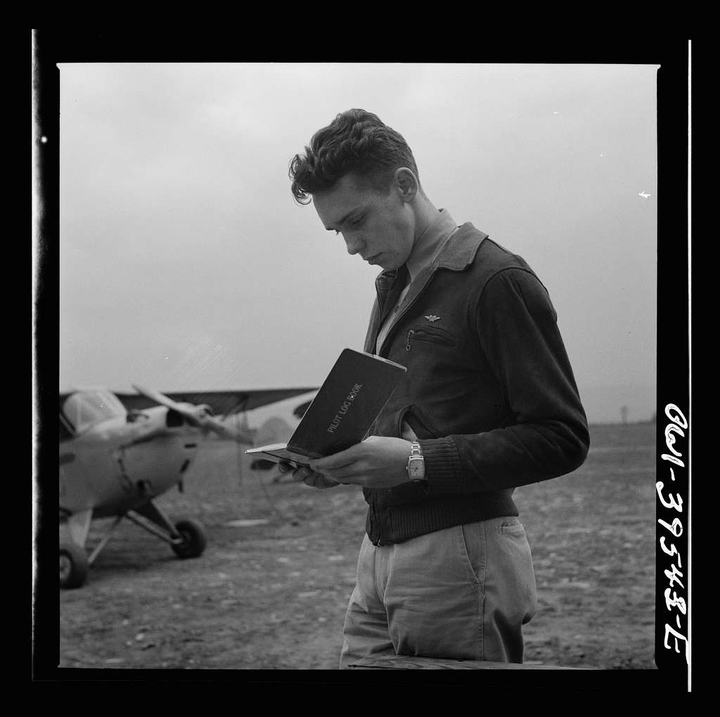 Frederick, Maryland. Walter Spangenberg, a student at Woodrow Wilson High School, filling out his pilot's log book after a solo flight at the Stevens Airport