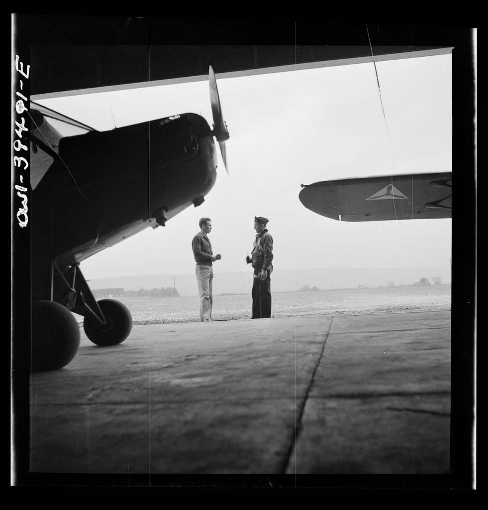 Frederick, Maryland. Walter Spangenberg, a student at Woodrow Wilson High School, talking to a friend at the Stevens Airport where he takes flying lessons