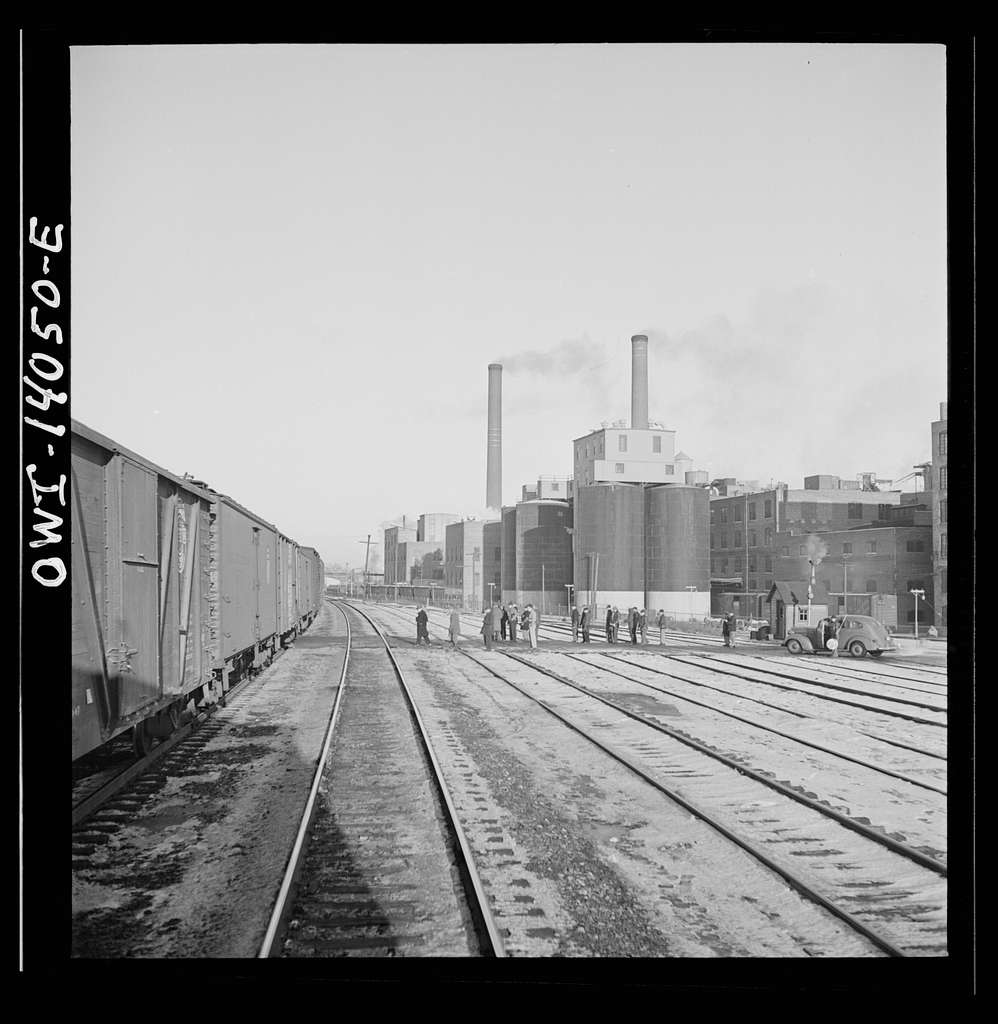 Freight train operations on the Chicago and Northwestern Railroad between Chicago and Clinton, Iowa. The train going through the town to the yard which is two miles beyond