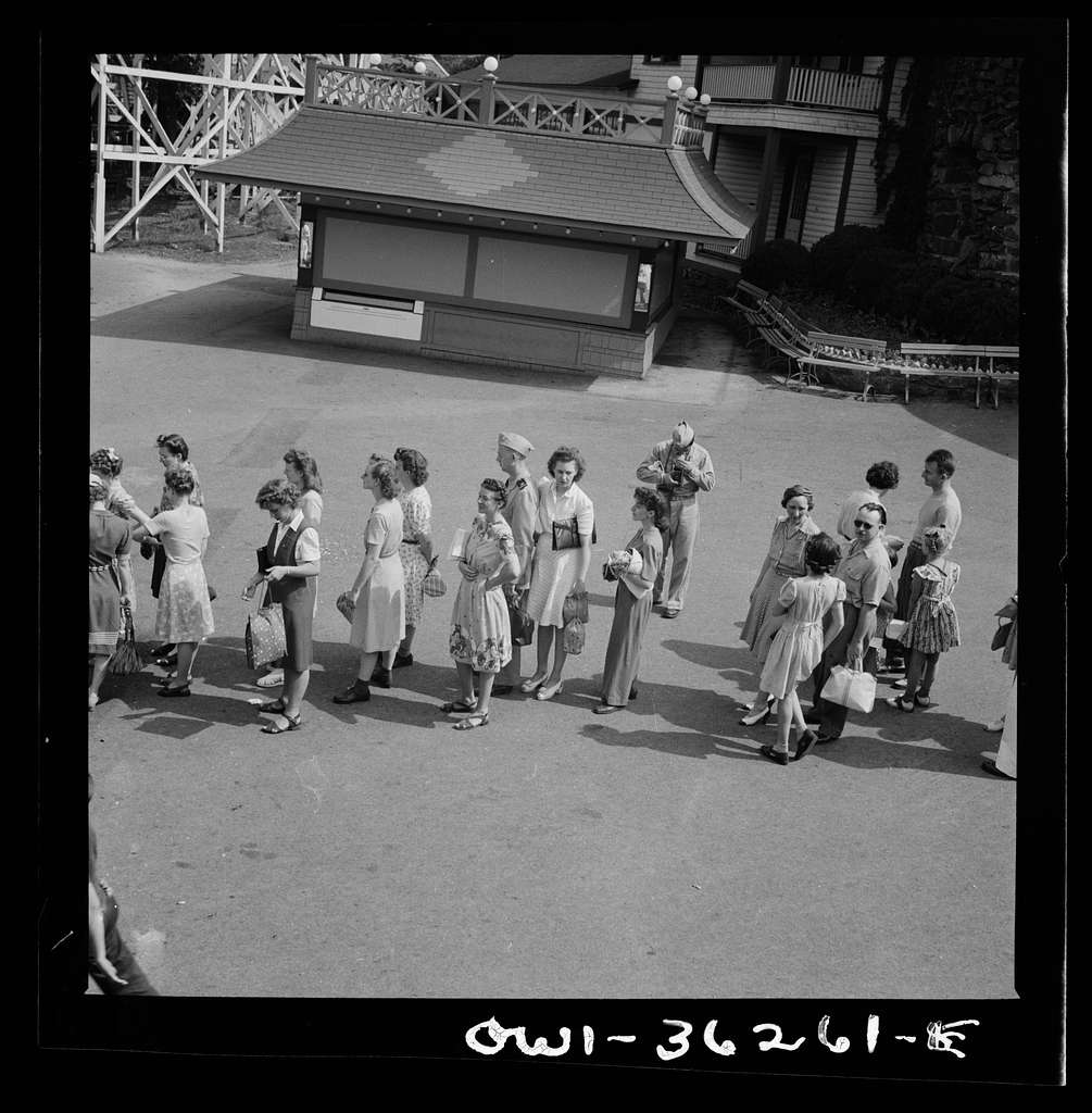 Glen Echo, Maryland. A line of people waiting to get into the swimming pool at the Glen Echo amusement park