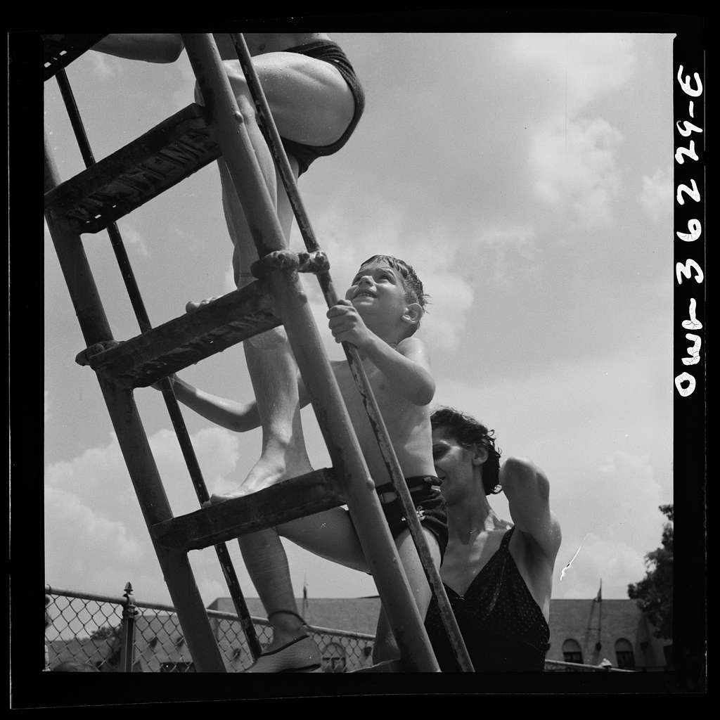 Glen Echo, Maryland. Climbing the ladder to the sliding board at the Glen Echo swimming pool