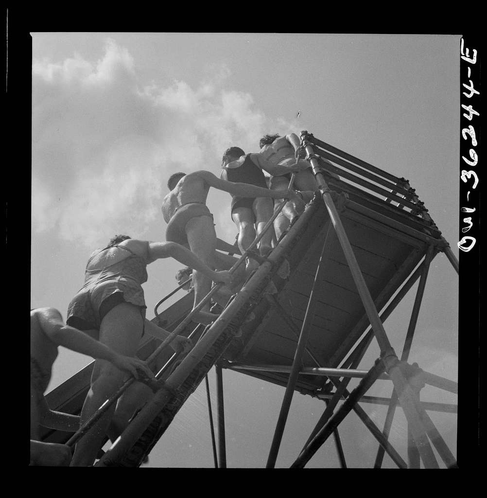Glen Echo, Maryland. Climbing the ladder to the sliding board at the swimming pool in the Glen Echo amusement park