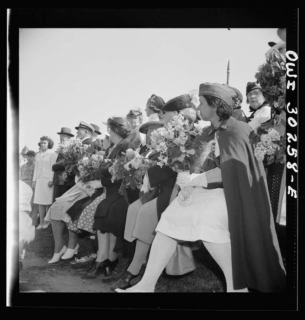 Gloucester, Massachusetts. Memorial Day, 1943. Memorial services for fishermen lost at sea. Here relatives of fishermen wait their turn to toss flowers into the water