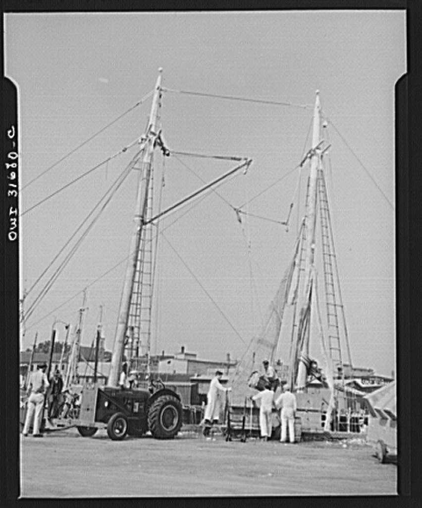 Gloucester, Massachusetts. Unloading redfish by motored crane on a dock