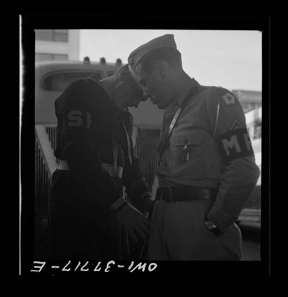 Indianapolis, Indiana. A shore patrol man and military policeman at the Greyhound bus terminal