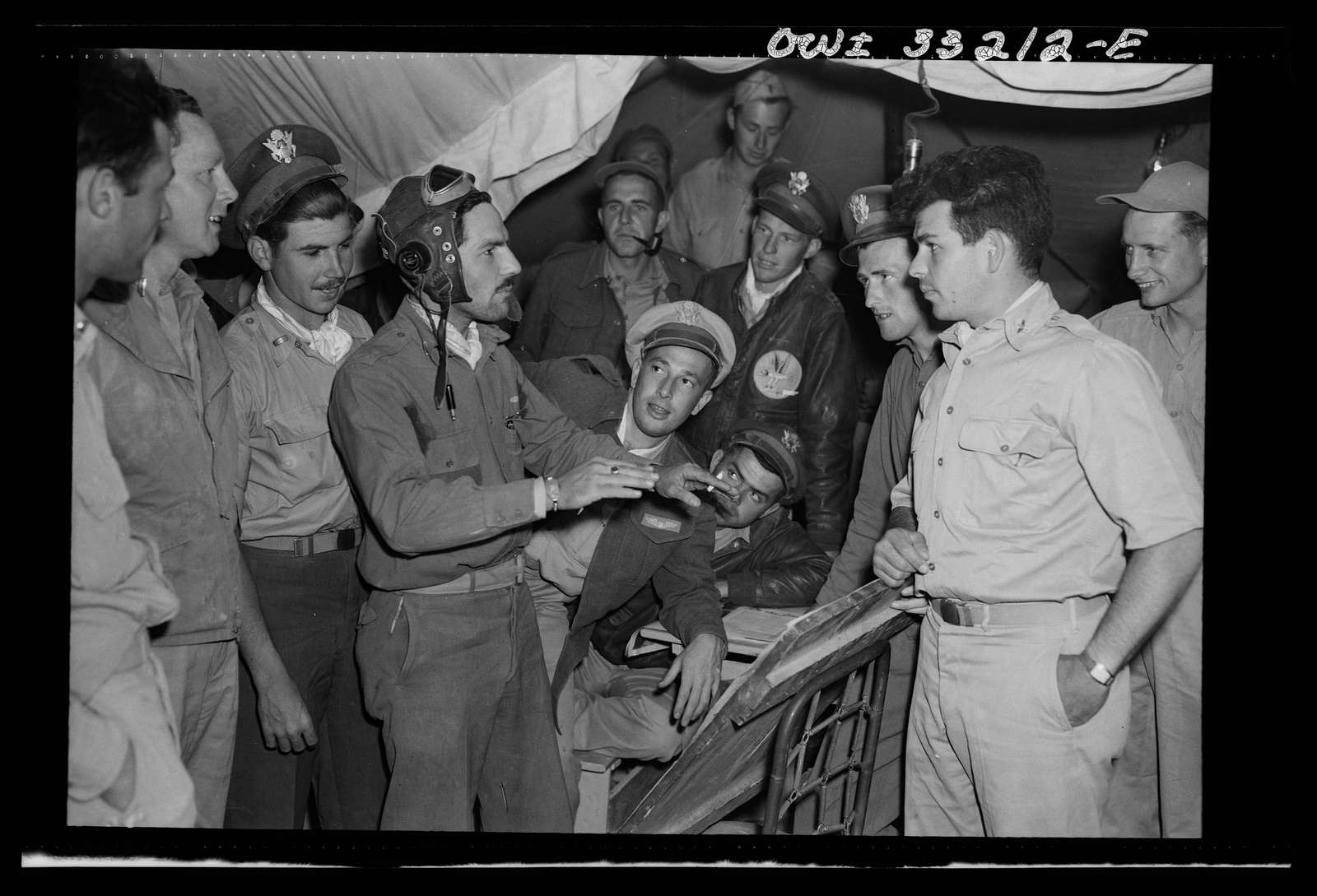 Lieutenant Richard E. Duffey, twenty-four, of Walled Lake, Michigan, giving an account at the 57th Fighter Group base in Tunisia of the actions of his group during the air battle of April 18, in which four squadrons of the 57th Fighter Group destroyed seventy-four enemy planes. Lieutenant Duffey destroyed five in a single engagement