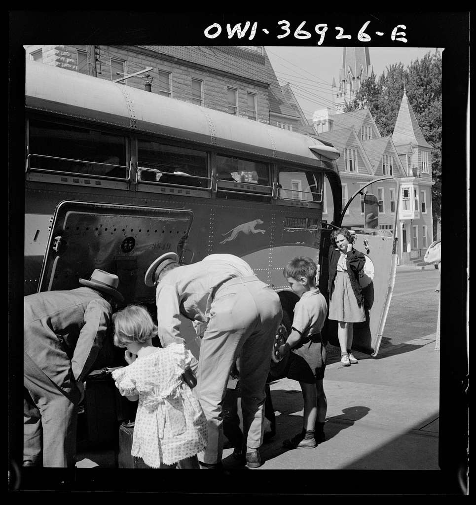 Passengers claiming their baggage at a Greyhound bus stop in a small town in Pennsylvania