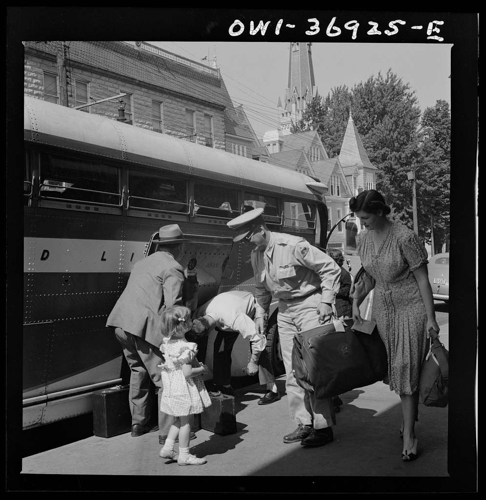 Passengers leaving a Greyhound bus in a small town in Pennsylvania