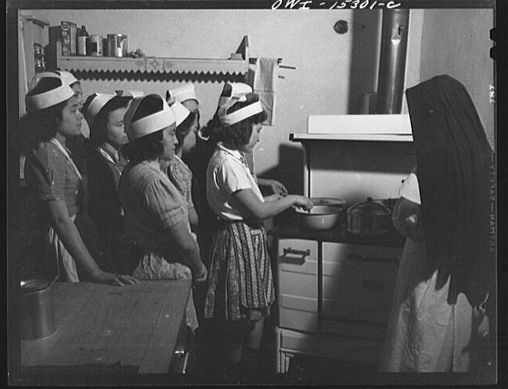 Penasco, New Mexico. Domestic science class in a high school supported by the state, but administered by the Catholic Church