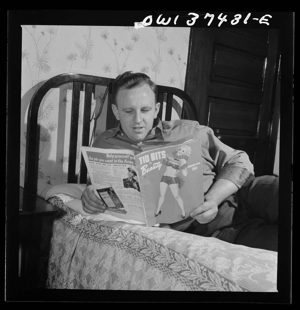 Pittsburgh, Pennsylvania. Clem Carson, a Greyhound bus driver, reading one of his favorite magazines. He and his roommate buy very few because so many are left on the buses. This one, however, was purchased