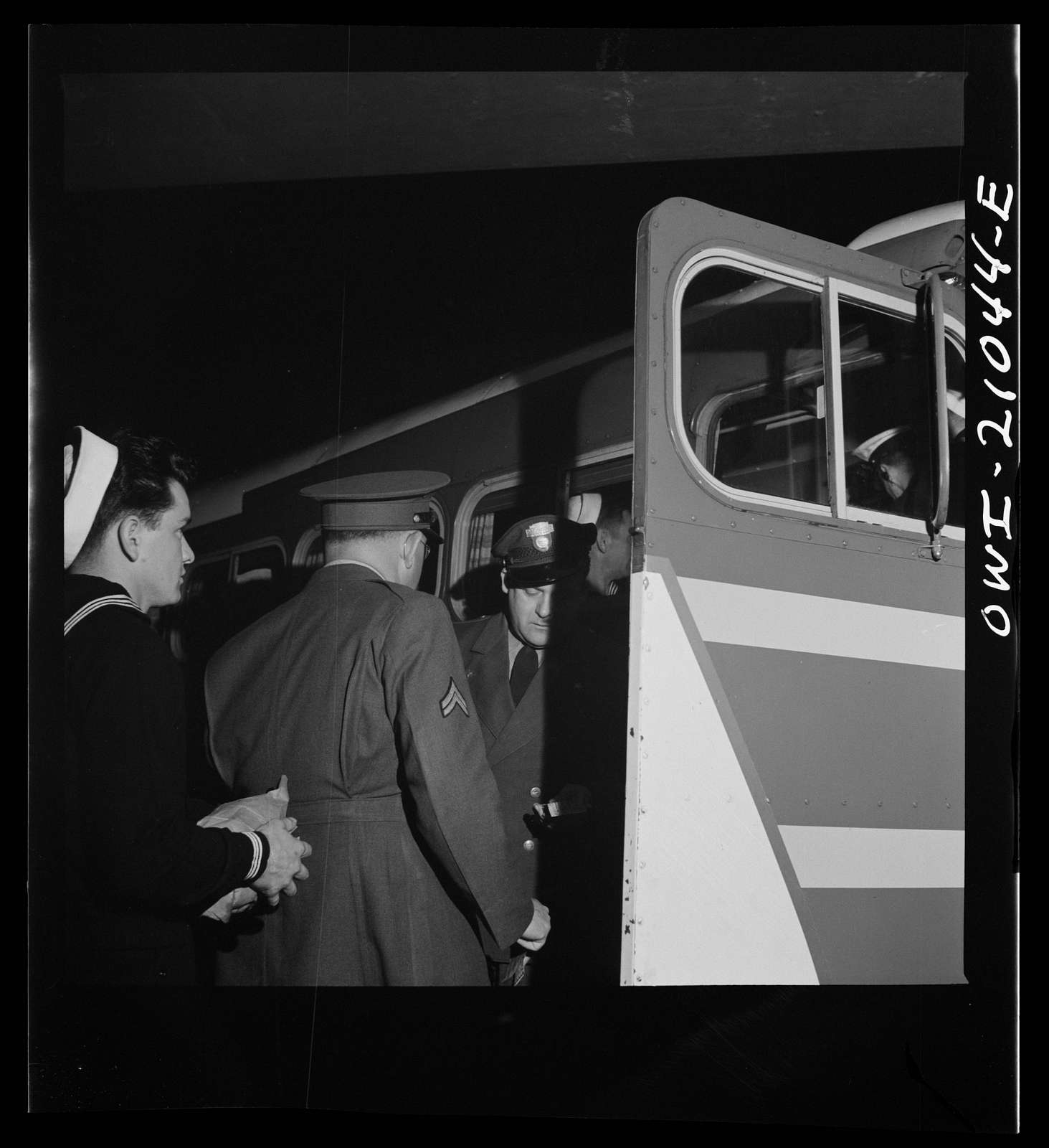 Washington, D.C. Boarding a special bus for servicemen. Leaving the Greyhound terminal on Sunday night