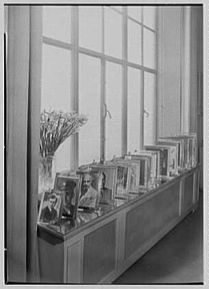 Ellen Ballon, residence at 2 W. 67th St., New York City. Picture frames on living room window sill