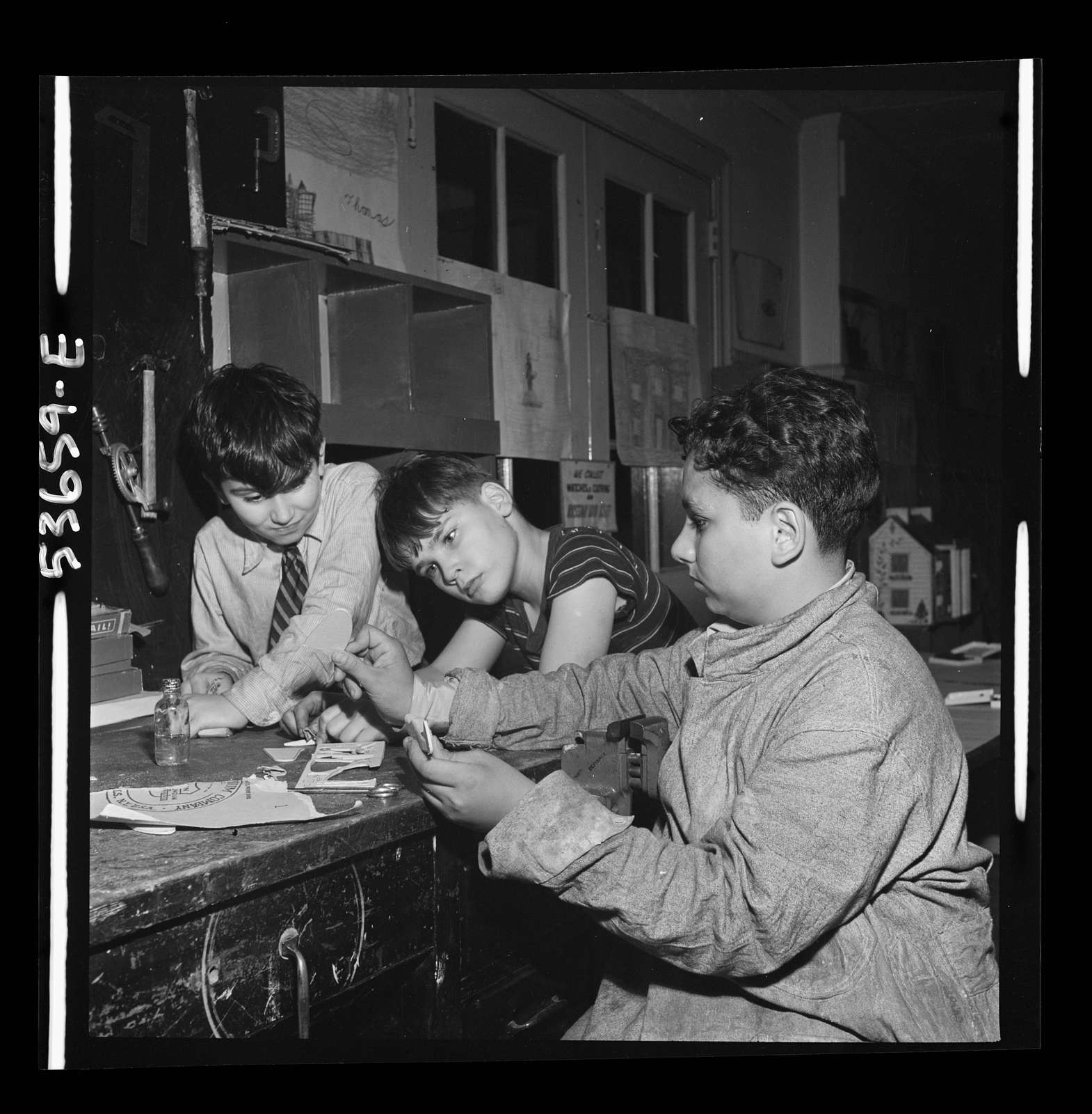 New York, New York. A fifteen-year-old expert on model airplanes who formerly spent Saturdays at the movies, devoting his time now to the instruction of younger boys enrolled in the after-school program at Greenwich House. Their mothers work