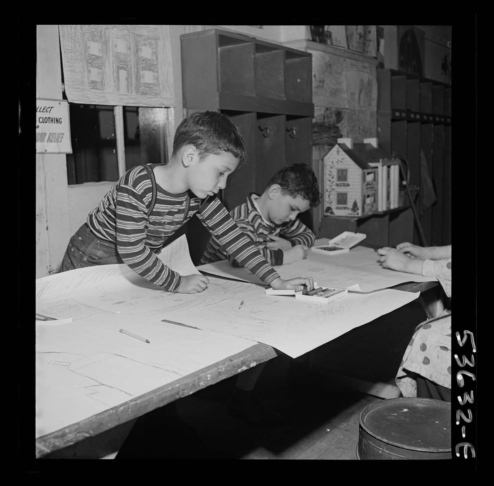 New York, New York. Two young boys, sons of working mothers, making drawings at Greenwich House, a community center where they are receiving day care