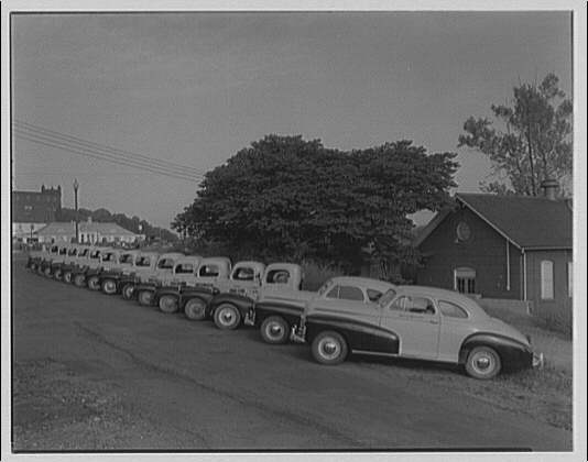 Griffith Consumers Co. Row of Griffith Consumers Co. service trucks II