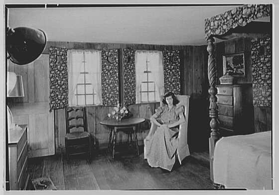 Gilbert house, residence in Sturrowtown, Massachusetts. Bedroom, with figure