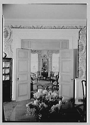 Mr. and Mrs. John Morgan, residence at 39 W. 11th St., New York City. Living room from dining room