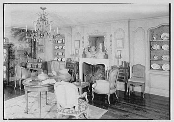 Mrs. Charles Henry Fallasse, Andely, residence in Cross River, New York. Living room, to fireplace