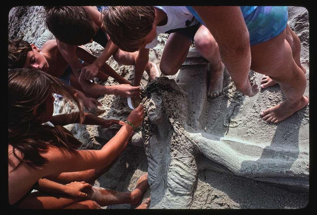 Sand sculpture of Christ on the cross, Matuneck Beach, Rhode Island