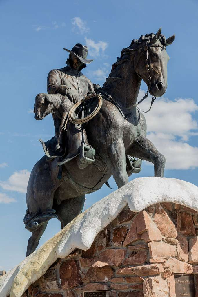 """A cowboy statue called """"20% Chance of Flurries,"""" in Casper, Wyoming. The work, by artist Chris Navarro, is a tongue-in-cheek reference to Wyoming cowboys' lot in winter: unpredictable, sideways blizzards in which they have to work, saving livestock, sometimes including newborn calves and lambs who would starve and freeze to death in the bitter cold"""