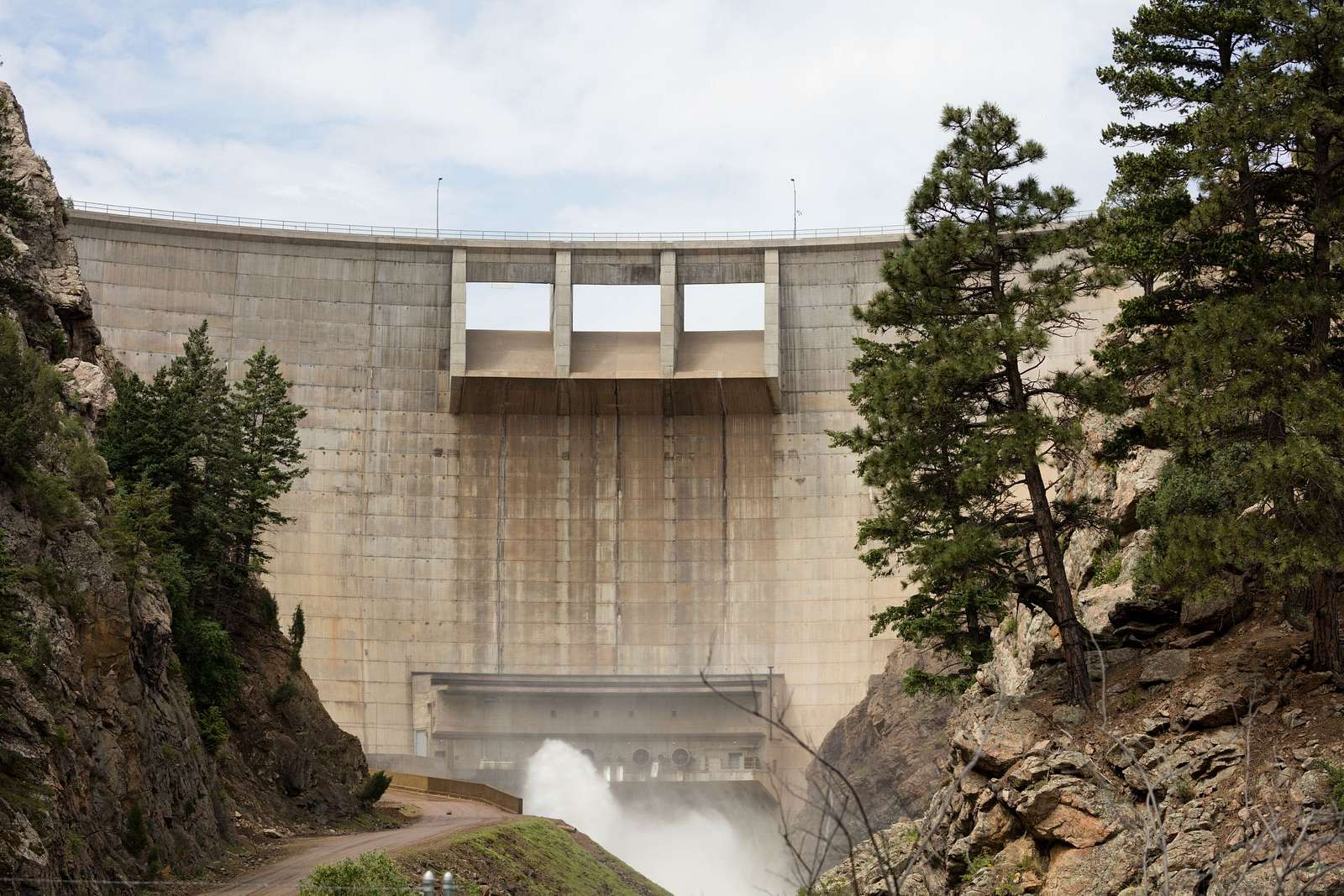 The roaring Strontia Springs Dam in Douglas, County, Colorado, diverts water from a giant reservoir into a 3.4 mile-long tunnel under the mountains to the Foothills Water Treatment Plant near Denver. Completed in 1983, this dam towers 243 feet above the South Platte River streambed, forming a 1.7-mile-long lake with 98 surface acres