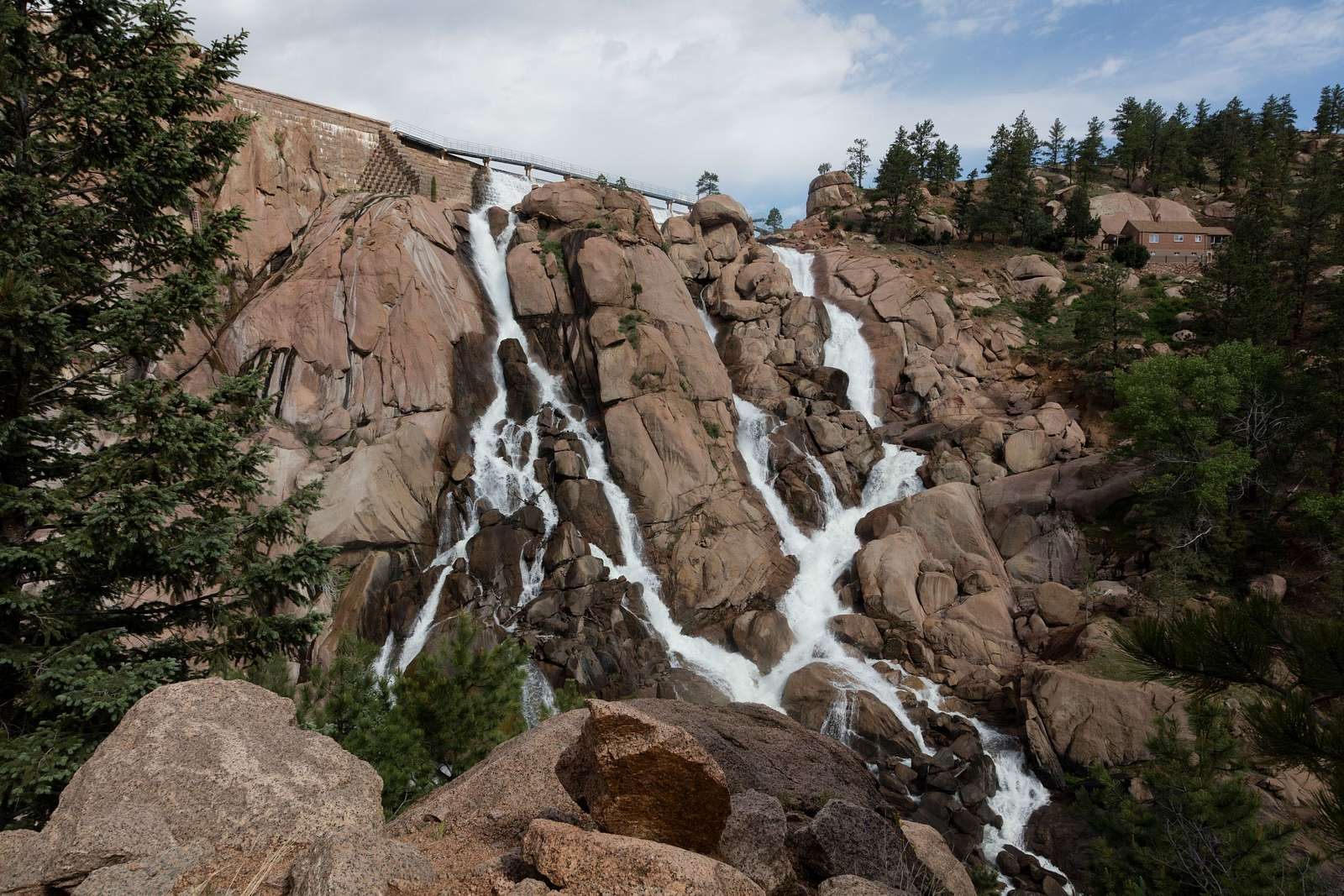 Water spills over the venerable Cheesman Dam in Jefferson County, Colorado. Cheesman is one of the dams that slows and captures water from the South Platte River for use as part of Denver's drinking-water supply. Cheesman Dam, which was named for Walter Scott Cheesman, a Denver druggist, railroad builder, and designer of water infrastructure, was the world's tallest at 221 feet when it was completed in 1905