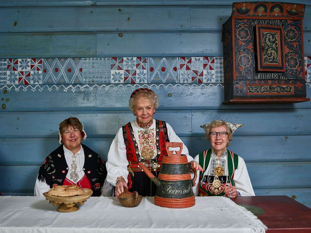 Women in traditional Norwegian clothing examine a loom at Vesterheim, the Norwegian-American museum and heritage center in Decorah, Iowa